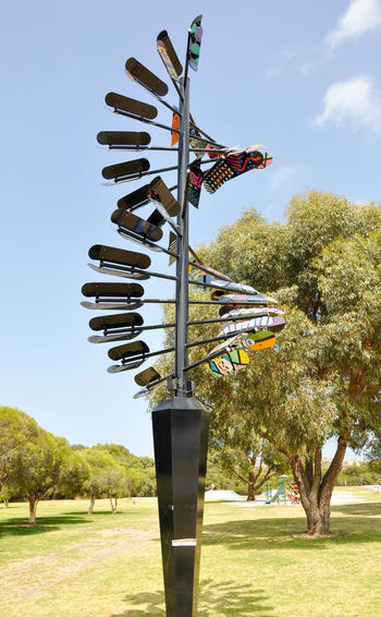 Unique solar powered rotating skateboard sculpture at the Spearwood skate park in Western Australia. Art ArtWork Colorful Creativity Day Deck No People Outdoors Park Rotating Sculpture Skateboard Skatepark Sky Solar Power Spearwood Spinning Sport Three-dimensional Trees Urban Vibrant Color Visual Statements Western Australia Youth Culture
