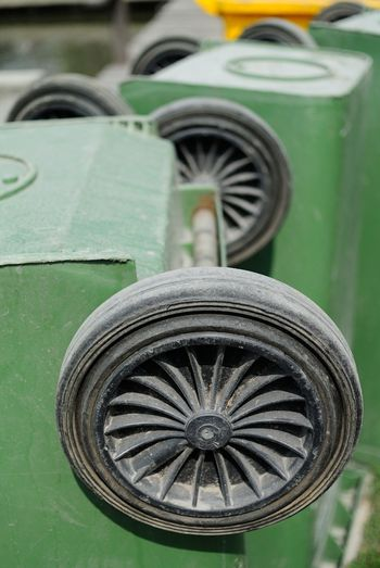 Close-up of garbage can wheels