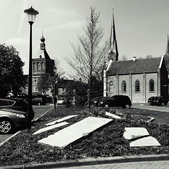 Parking place build on an old cemetary. Decorated it with some old tombstone. Art or distasteful? Blackandwhite Black And White Black & White Streetphoto_bw