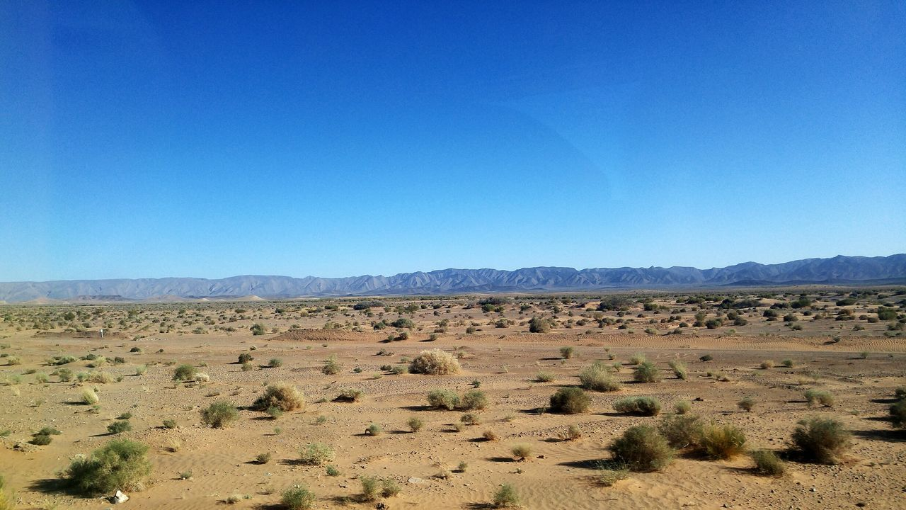 blue, landscape, clear sky, nature, tranquil scene, copy space, scenics, day, no people, arid climate, beauty in nature, tranquility, outdoors, mountain, desert, sky