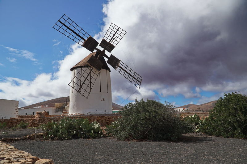 Fuerteventura Windmill Alternative Energy Architecture Building Exterior Built Structure Cloud - Sky Day Environmental Conservation Fuel And Power Generation Industrial Windmill Nature No People Outdoors Renewable Energy Rural Scene Sky Solar Energy Solar Equipment Solar Panel Technology Traditional Windmill Wind Power Wind Turbine Windmill