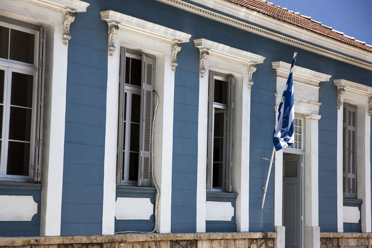 Architecture Blue Building Building Exterior Built Structure City City Life Colors Day Elégance Flag Greek Flag Lifestyles Neoclassical Old Old Fashioned Outdoors Sky Style Windows