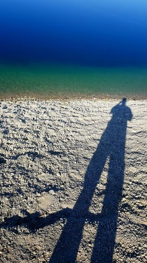 Beauty In Nature Day Field Focus On Shadow High Angle View Land Leisure Activity Lifestyles Long Shadow - Shadow Men Nature One Person Outdoors Real People Shadow Standing Sunlight Tranquility Unrecognizable Person