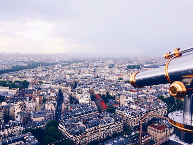 View from the top. Paris Eiffel Tower Lookout City Cityscapes Telescope Historical Building Urbanphotography Urban Landscape Gold Clouds And Sky Atmospheric Mood