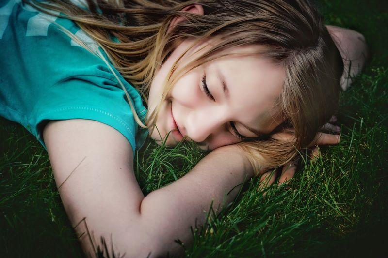 Smiling girl lying on field
