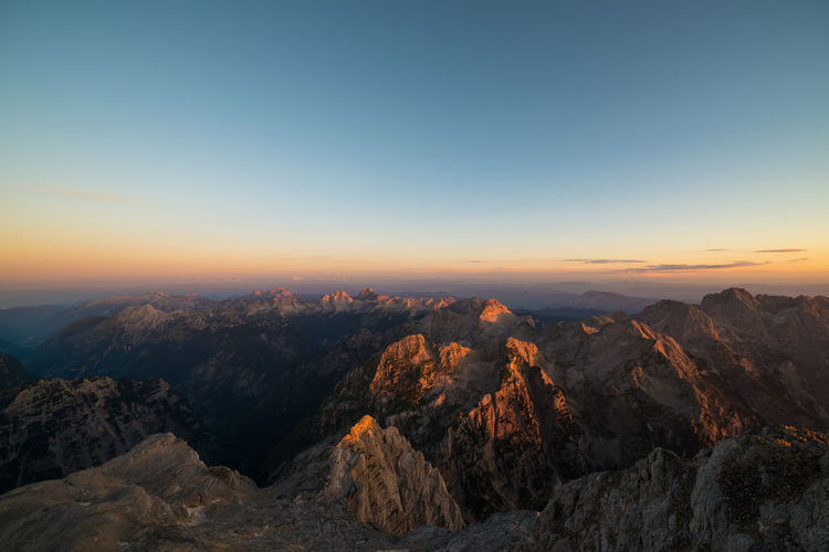 Morning view from the top of Triglav Alps Beauty In Nature Blue Dawn Horizon Over Land Idyllic Landscape Majestic Morning Mountain Mountain Range Nature No People Outdoors Remote Rock Rock Formation Scenics Sky Slovenia Sunrise Tranquility Travel Destinations