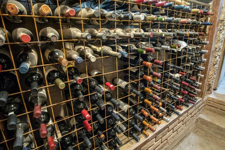 Aerial view of wine bottles in rack