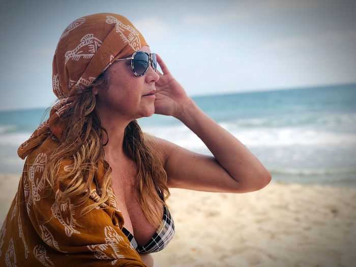Young woman wearing sunglasses on beach