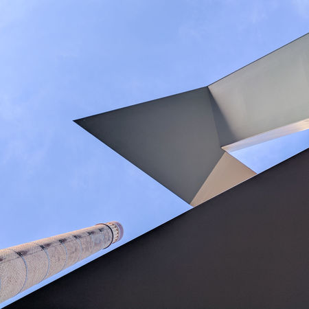 Angles Architectural Feature Architecture Blue Building Exterior Built Structure Day Low Angle View No People Outdoors Pointy Sharp Sky Smokestack Stairs The Graphic City