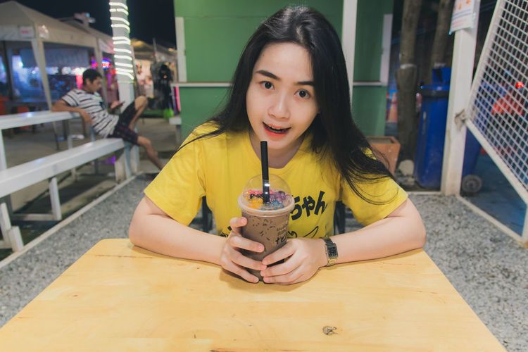 Food And Drink Portrait Front View Restaurant Drink One Person Straw Real People Looking At Camera Sitting Drinking Straw Refreshment Table Hair Long Hair Incidental People Cafe Casual Clothing Holding Glass Hairstyle Drinking Beautiful Woman