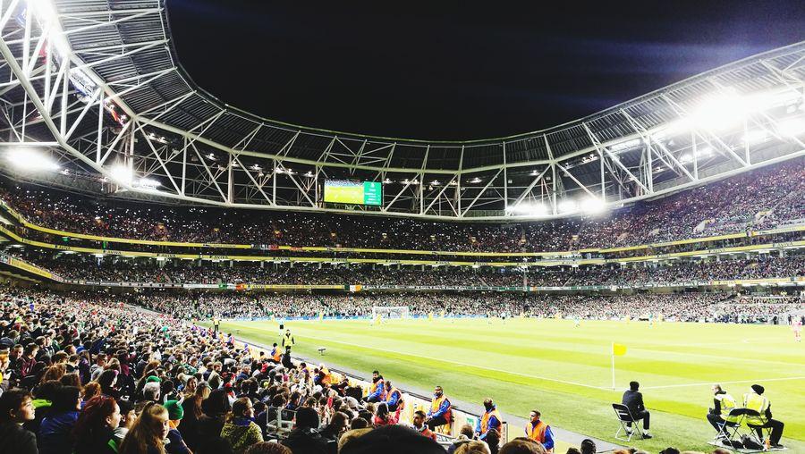 Crowd on soccer stadium at night