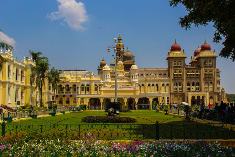 Mysore Palace Architecture Building Exterior Built Structure City Day Dome Façade Formal Garden Government Building Grass History Horizontal Large Group Of People Outdoors People Sky Travel Destinations Tree