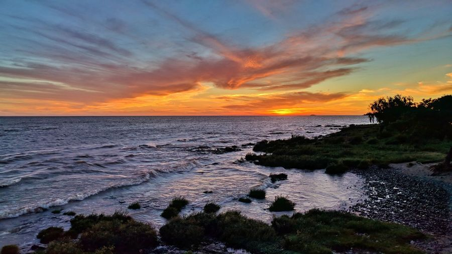 Sunset in Colonia Del Sacramento, Uruguay. EyeEmSelect River Riverside Colors Colorful Sunset_collection Sky Wave Green Color Blue Sunset Sea Beach Water Reflection Nature Horizon Over Water Scenics Landscape Outdoors Sky Vacations Travel Destinations Low Tide Dusk Tourism Tranquil Scene Travel Tranquility Beauty In Nature EyeEmNewHere Summer Exploratorium Summer Exploratorium This Is Latin America The Great Outdoors - 2018 EyeEm Awards Capture Tomorrow My Best Photo