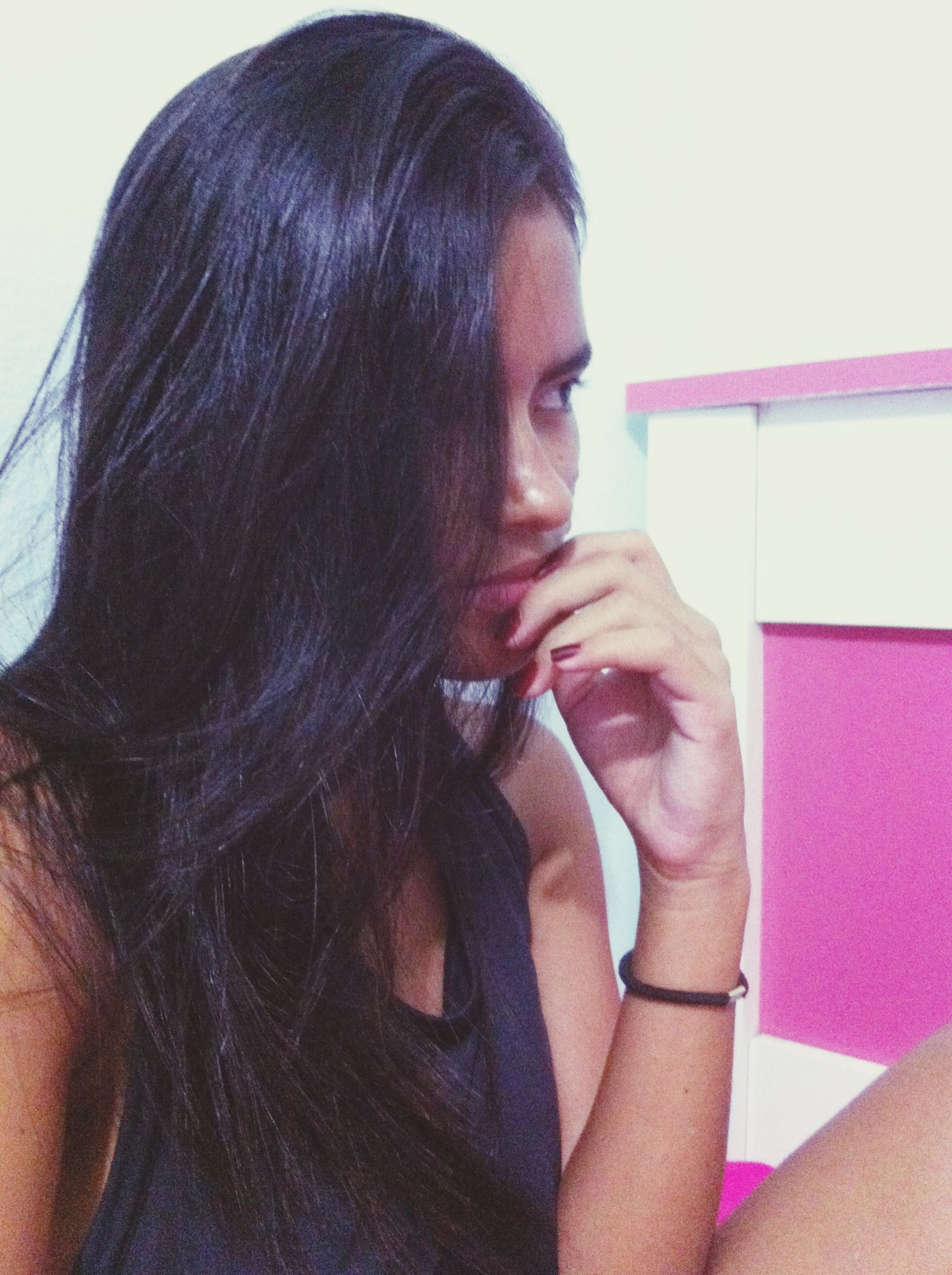 young adult, young women, person, headshot, long hair, lifestyles, indoors, front view, portrait, casual clothing, leisure activity, looking at camera, black hair, head and shoulders, close-up, contemplation