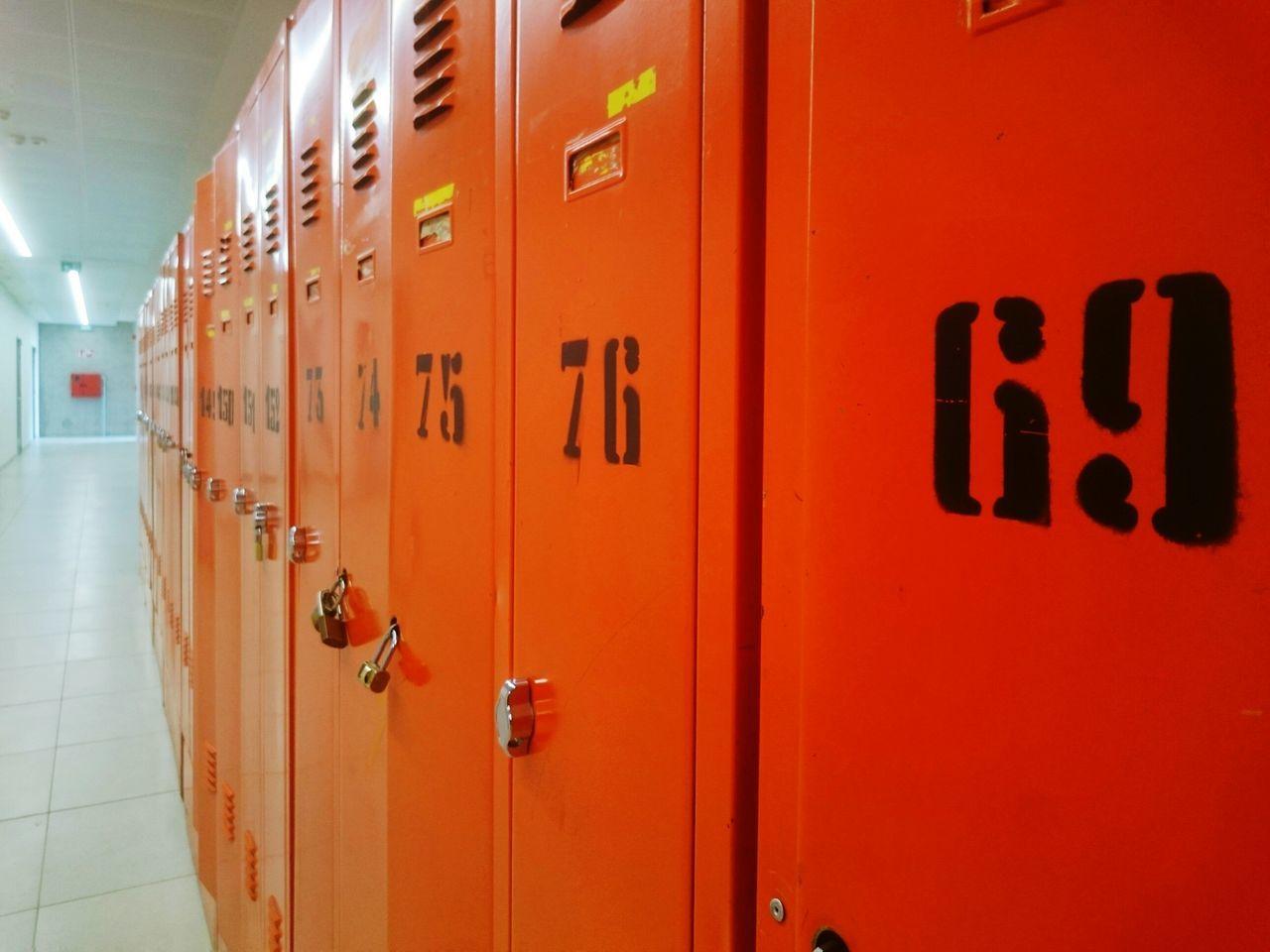 Orange Lockers In Illuminated Room