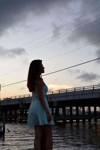 Water Sky One Person Sunset Standing Lifestyles Architecture Real People Young Adult Leisure Activity Three Quarter Length Built Structure Nature Cloud - Sky Young Women Women Adult Connection Hairstyle Bridge - Man Made Structure Beautiful Woman Outdoors Nikon Model Standing Alone Brunette Brunette Girl  Ocean City Bridge Long Hair Blue Dress 25-30 Years Old Slim Girl
