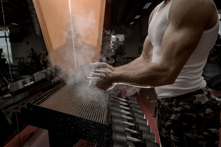 Midsection of man hands with talcum powder