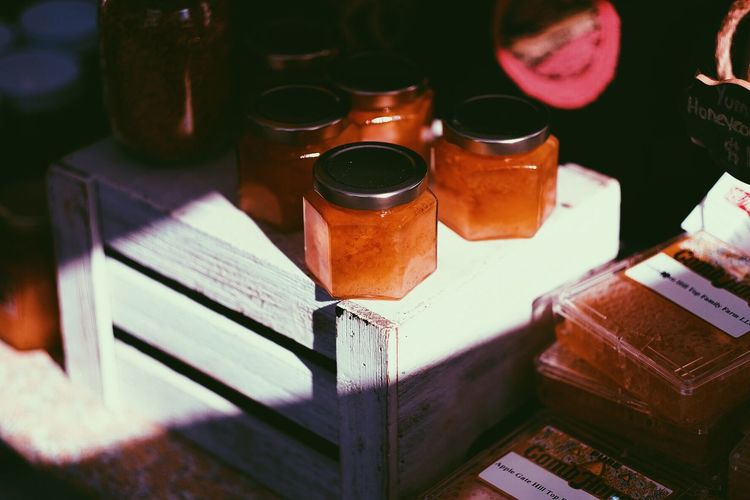 High angle view of honey in glass jars