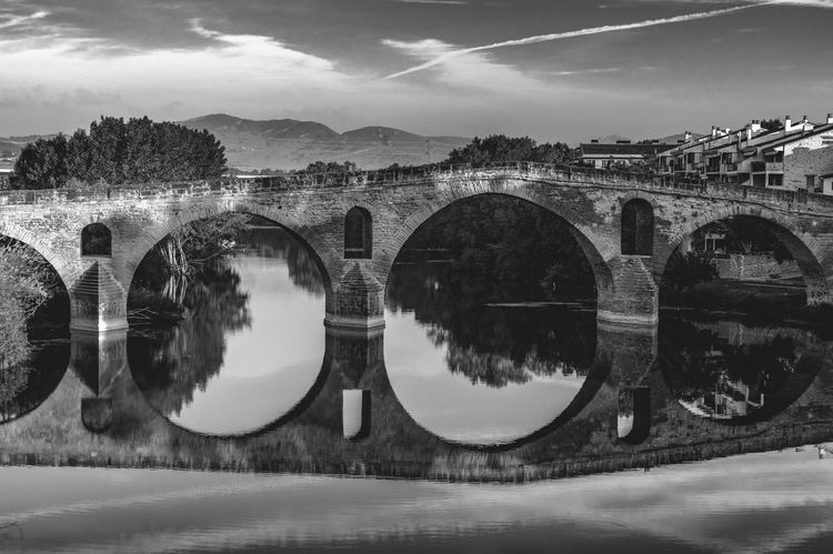 Bridge CaminodeSantiago Jakobsweg Puente La Reina SPAIN St James Way The Photojournalist - 2017 EyeEm Awards Pilgrimage Theway Photojournalism Stjamesway  Last Autumn (september/october 2016) I traveled alone to France and Spain to work on my Photography Documentary Project called Faces and Places of the Camino de Santiago. I walked the French Way, from Saint Jean Pied de Port(France) to Santiago de Compostela (Spain), more than 800 km with my backpack and my Camera. The project was to photograph the Camino and the Pilgrims with a Pilgtim's Eyes. My goal with this project was not to photograph monuments or lsndscspes, all I tried to photograph was the mood and the spirit of the Camino. The project in a near future is to turn into a Photography book that willl be called The Ride - A Photographer's Journey thru the Camino de Santiago! Hope you all enjoy the Ride thru my images.... Black And White Friday