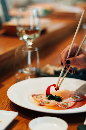 Woman eating Japanese food. Eating Woman Eating Japense Food Japan Chopsticks Sashimi  Lunch Dinner Food And Drink Human Hand Food Freshness Hand Indoors  Holding One Person Table Close-up