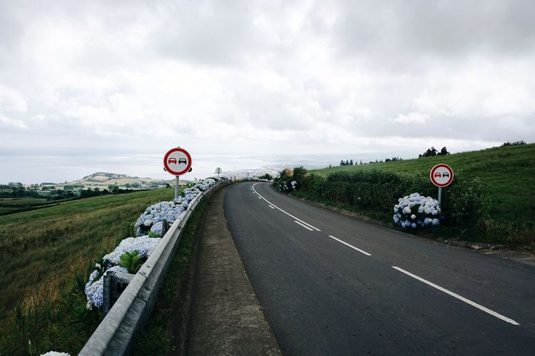 on the road, Portugal Road Sign Road Speed Limit Sign Clock Face Warning Sign Number Text Sky Landscape Cloud - Sky Traffic Arrow Sign Information Sign One Way Road Warning Sign Do Not Enter Sign Street Name Sign Stop - Single Word Empty Road Road Marking Information Directional Sign