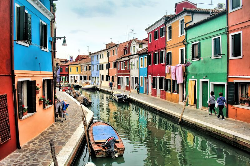 Architecture Boats Building Exterior Built Structure Canal Canals City Cultures Day Europe Gondola - Traditional Boat Italy Multi Colored Murano Nautical Vessel Outdoors Rear View Sky Transportation Travel Destinations Venetian Venice Water Waterfront Waterways