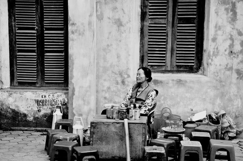 Waiting Real People One Person Day Outdoors Lifestyles Sitting Leisure Activity Street Photography Street Streetphoto_bw Building Exterior Architecture Built Structure People Black & White Photography Blackandwhitephoto Blackandwhite Photography Blackandwhitephotography Black&white Black And White Portrait Black And White Collection  Waiting Wait waiting game Streetphotography