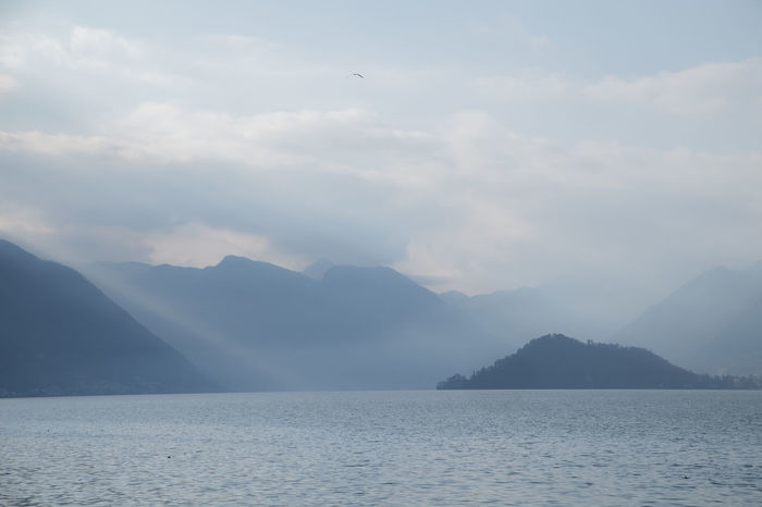 Como Beauty In Nature Comolake Day Mountain Mountain Range Nature No People Outdoors Scenics Sea Sky Tranquil Scene Tranquility Water Waterfront