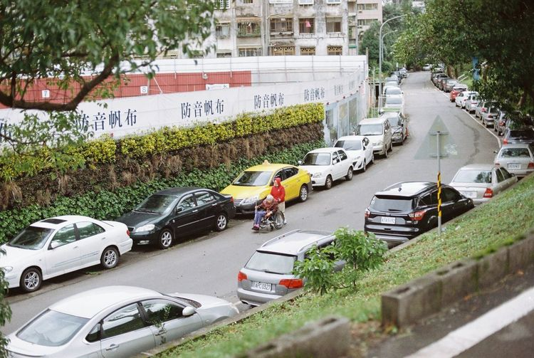 High angle view of vehicles on road along buildings