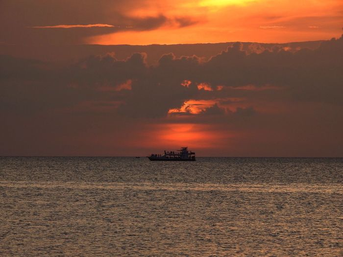 Watch the Sunset Sky Sunset Sea Water Beauty In Nature Cloud - Sky Scenics - Nature Transportation Orange Color Nature Tranquil Scene Beach Tranquility Horizon Mode Of Transportation Horizon Over Water Silhouette Dramatic Sky