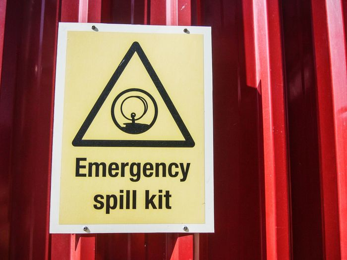 Emergency spill kit safety signage at a chemical warehouse Communication Close-up Day No People Yellow Signage On Building Signage Safety Safety Equipment Safety Sign Chemical Safety Warning Sign Reminder Spillage Chemical Spill