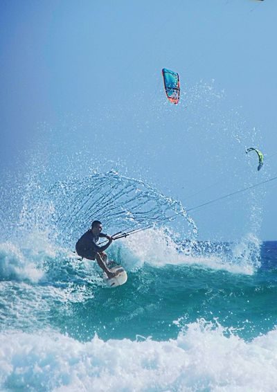 Leisure Activity One Man Only Vitality Water Splashing Challenge Full Length Motion Sky Sport Adventure Freedom Agility Outdoors Blue Rio De Janeiro Aquatic Sport Wave Windsurfing Kite - Toy Kiteboarding Extreme Sports Beach Beauty In Nature Scenics