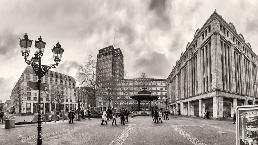 DUESSELDORF, GERMANY - JANUARY 05, 2017: High resolution, hyperrealistic panoarama of famous Heinrich Heine Platz with Carsch Haus Black & White Film Grain Emulation