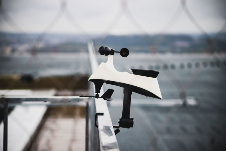 Close-up of coin-operated binoculars against sky