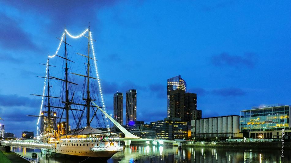 Arquitecture Blue Boat Bridge Buenosaires Argentina City Cityscapes Frigate Illuminated Lights Modern Lights Ship Puentedelamujer Reflection River Sky Water Evening Sky Evening The Architect - 2016 EyeEm Awards The Great Outdoors With Adobe