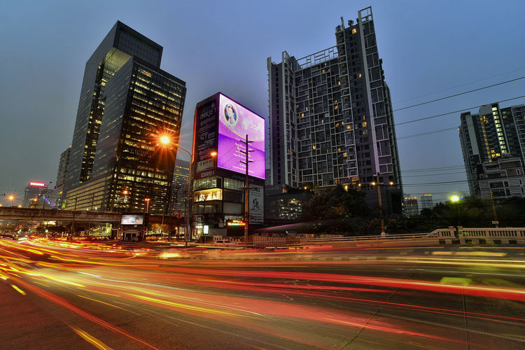 traffic in the city at night thailand Cityscape Outdoors Modern Tall - High No People Nature Office Road Skyscraper Blurred Motion Sky City Life Night Light Trail Office Building Exterior Speed Street Building Long Exposure Motion Built Structure Illuminated City Architecture Building Exterior Light Financial District