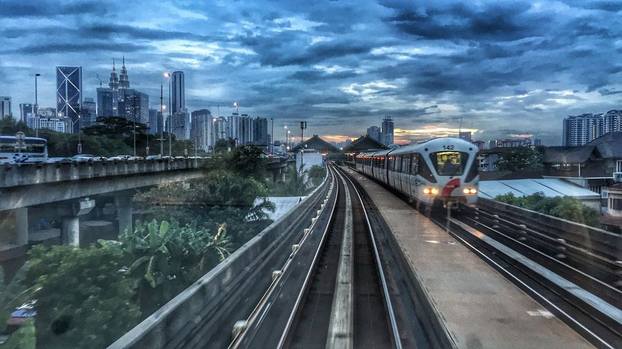 Coming Train City Architecture Transportation Building Exterior Built Structure Sky Skyscraper High Angle View Railroad Track Mode Of Transport Cityscape Cloud - Sky Rail Transportation City Life Bridge - Man Made Structure Illuminated Train - Vehicle The Way Forward Outdoors