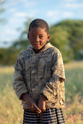 Portrait of boy standing on field
