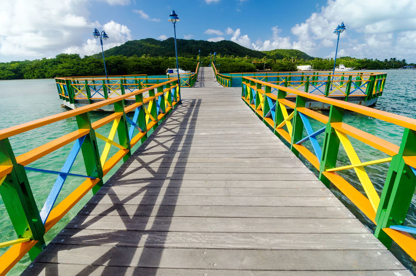 A colorful bridge connecting two islands in San Andres y Providencia, Colombia Bay Beach Beautiful Calm Caribbean Coast Coastline Coconut Colombia Day Holiday Hot Idyllic Island Landscape Nature Ocean Outdoor Palm Providencia Resort Sand Scenery Scenic Turquoise
