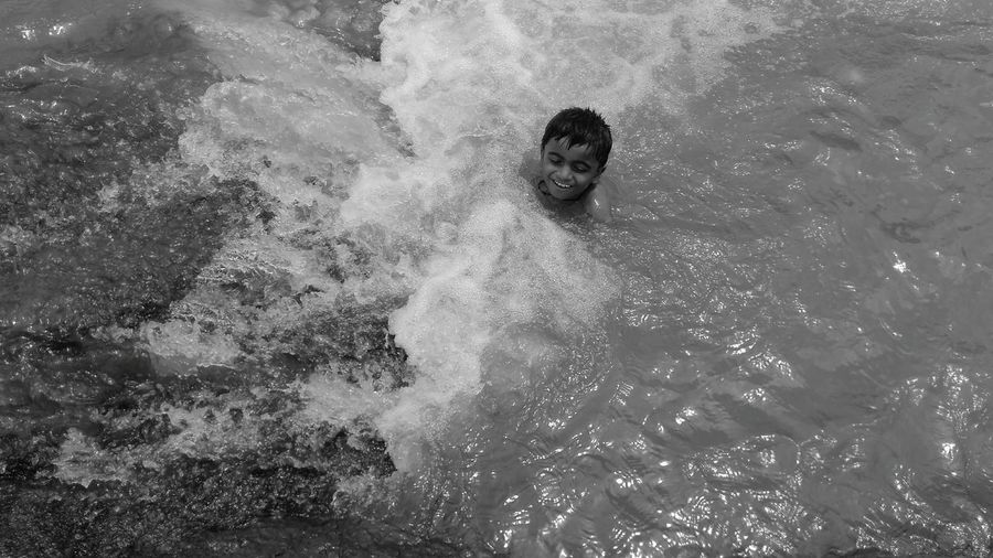 Kid playing in water! Kid Wanderer Nature Stream Waterfall India Swimming Swimmer Son
