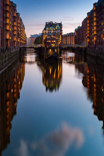 Speicherstadt at sunset, Hamburg - Germany Hamburg UNESCO World Heritage Site Architecture Bridge Bridge - Man Made Structure Building Building Exterior Built Structure City Dusk Germany Illuminated Nature No People Outdoors Reflection River Sight Sky Speicherstadt Sunset Travel Destinations Unesco Water Waterfront