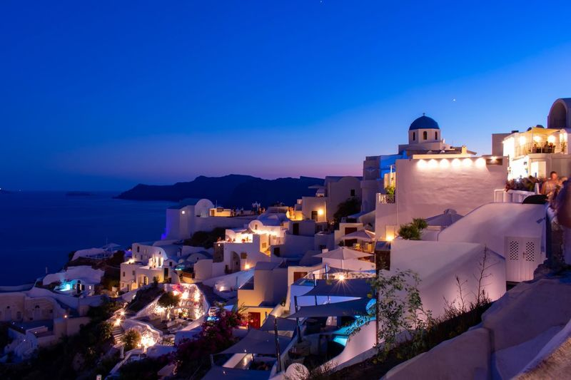 Ia at night Clouds Houses Santorini Long Exposure EyEmNewHere Illuminated Architecture Sky Built Structure Sea Building Exterior Water Blue High Angle View Building Nature Night Clear Sky Travel Destinations Dusk City Travel Tourism No People Outdoors Capture Tomorrow
