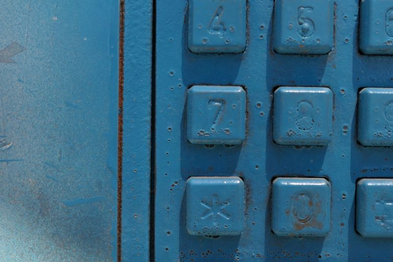 Close-up of buttons on pay phone