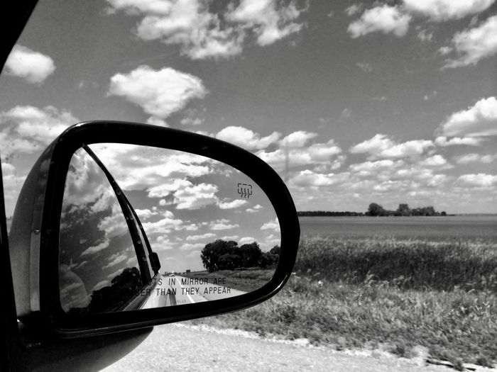 Landscape in a car's mirror, South Dakota, USA Schwarzweiß Landschaft Spiegel Road Movie Fahren Auto Amerika Black And White Mirror Driving South Dakota Highway Americana USA Cloud - Sky Sky Side-view Mirror Car Motor Vehicle Transportation Mode Of Transportation Mirror Landscape Vehicle Mirror Reflection