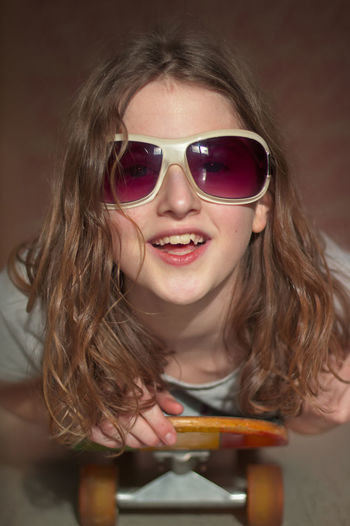 Lisa-djright Lisa-djright Glasses Sunglasses Childhood Girls Smiling Portrait Hairstyle Front View One Person Females Fashion Long Hair Happiness Innocence Child Skate Skatelife Skateboarding Skate Photography: Same Tricks, New Perspectives My Best Photo Streetwise Photography