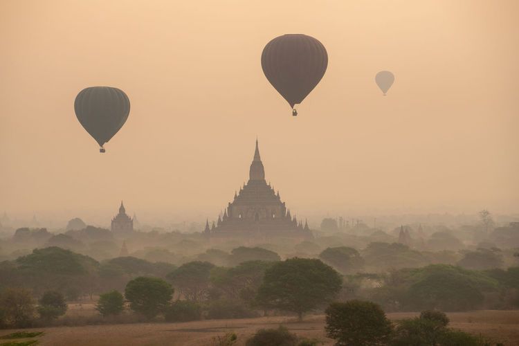 Hot air balloon in Bagan Mandalay Myanmar Hot Air Balloon Air Vehicle Place Of Worship Architecture Sky Building Exterior Travel Destinations Built Structure Balloon History Travel Fog Nature The Past Flying Religion Tourism Transportation Ancient Belief No People Outdoors Ancient Civilization Bagan Myanmar Burma Mandalay Landmark Stupa ASIA Buddhism Temple - Building