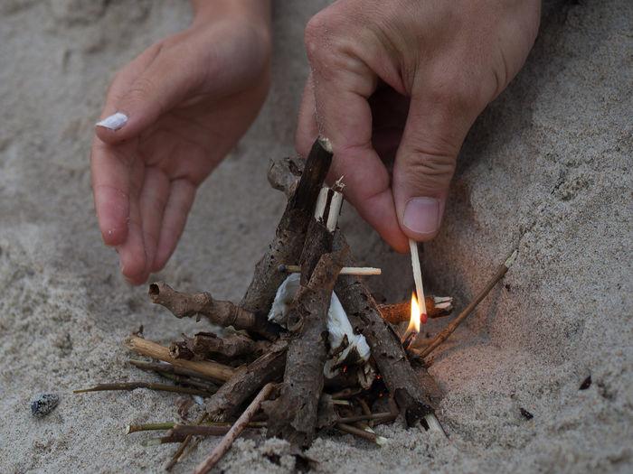 People lighting a fire