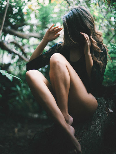 Cloudy Creativity Darkness And Light Day EyeEmNewHere Forest Legs Lifestyles Mood Nature One Person Outdoors People Portrait Real People Shadows & Lights Sitting Tree Young Women