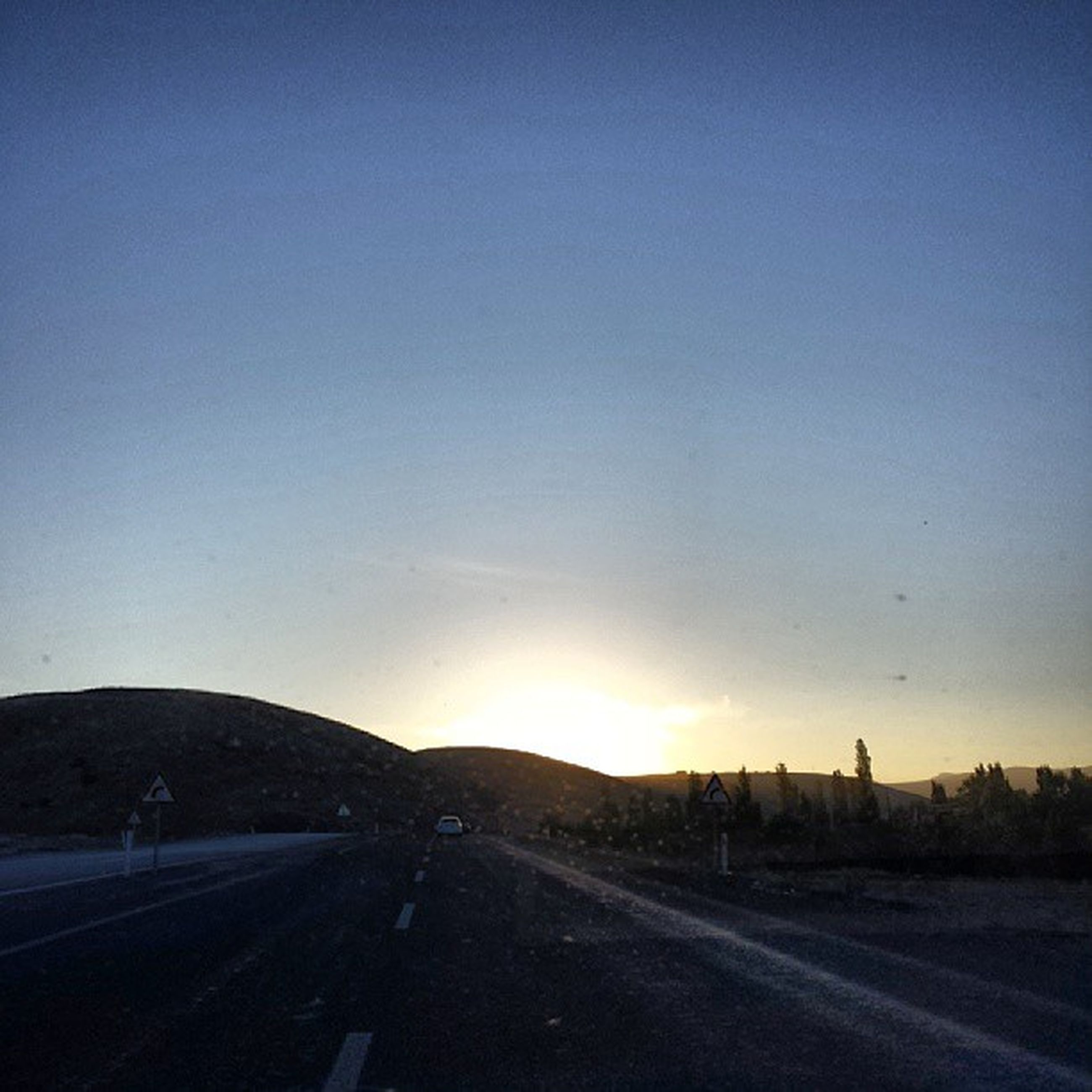 road, the way forward, transportation, road marking, copy space, clear sky, diminishing perspective, vanishing point, sunset, sky, street, country road, blue, empty, empty road, car, landscape, tranquility, tranquil scene, asphalt