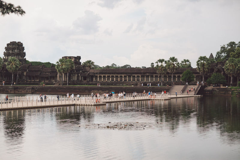 Siem Reap Cambodia Angkor Angkor Wat Angkor Wat, Cambodia Water Group Of People Architecture Sky Built Structure Large Group Of People Nature Day Real People Crowd Tree Plant Building Exterior Men Waterfront Lifestyles Travel Lake Outdoors